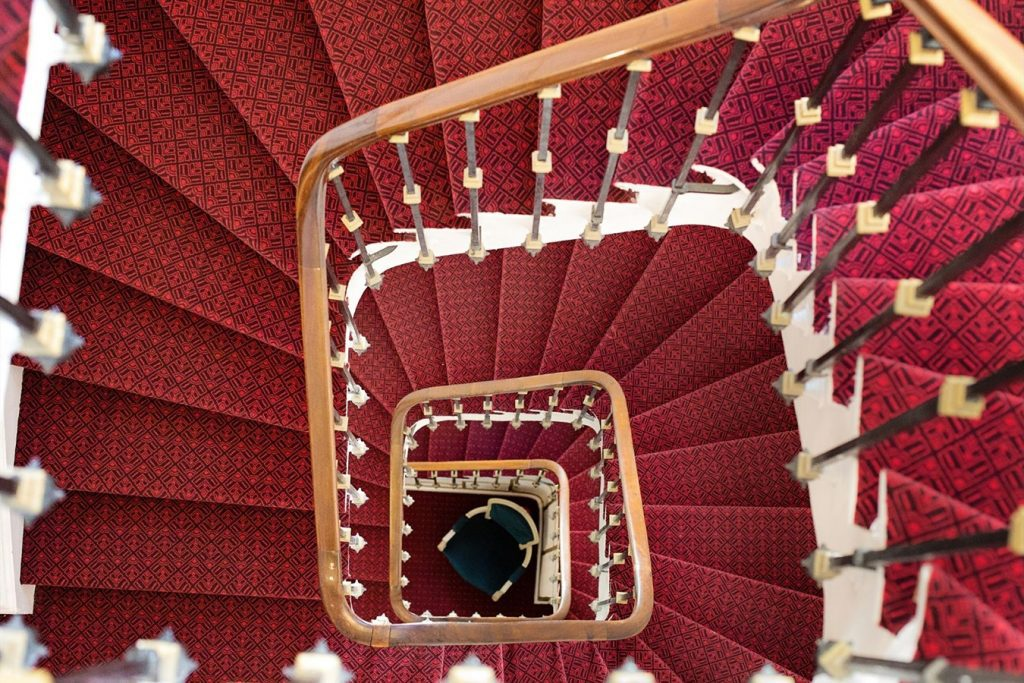 red steps pattern daily grind winding steps moving up repetition